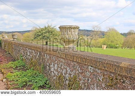 Stone Urn On A Wall In A Garden