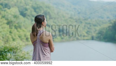 Sport woman look at the lake view