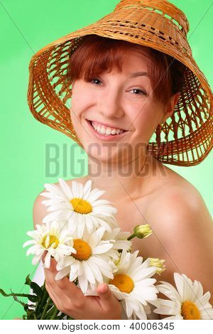 Smiling Young Girl In The Hat With Chamomile Flowers