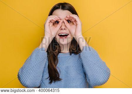 Curious Young Girl Observing Distant Horizon, Watching Through Binoculars Hand Gesture, Brunette Wom