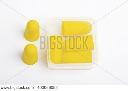 Yellow Ear Plugs Isolated On A White Background