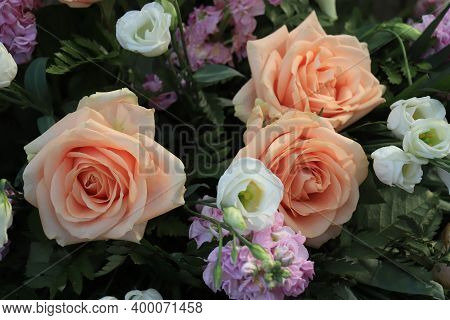 Peach Colored Roses In A Big Wedding Centerpiece