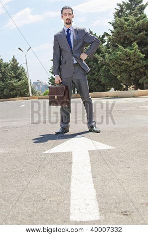Businessman ready to start running