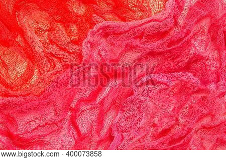 Bright Two-tone Background Of Crumpled Colored Gauze. Pink And Red Gauze. Used In Design For Decorat