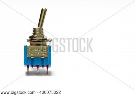 Closeup Image Of Two-positional Toggle Switch Placed On White Background.
