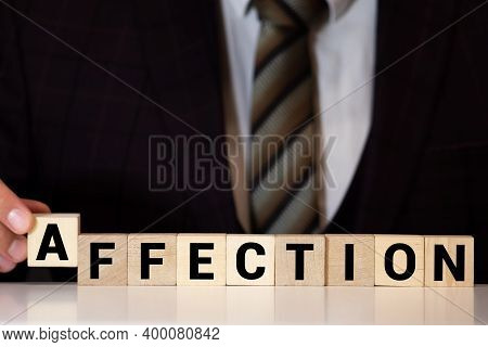 Affection Text On Wooden Block On Black Texture Background.