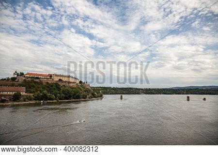 Petrovaradin Fortress In Novi Sad, Serbia, On Danube River, On A Cloudy Afternoon. This Castle Is On