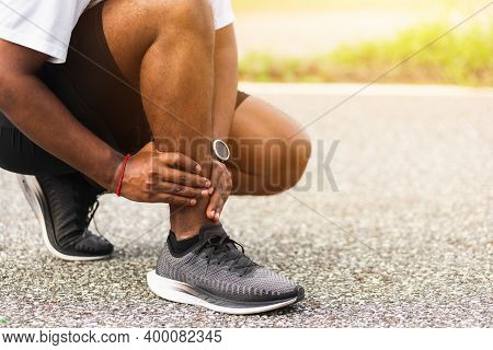 Close Up Asian Young Sport Runner Black Man Wear Watch Hands Joint Hold Leg Pain Because Of Twisted
