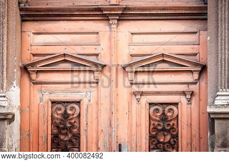 Detail Of An Old Vintage Orange Wooden Door On The Front Entrance Of A Residential Building In Vojvo