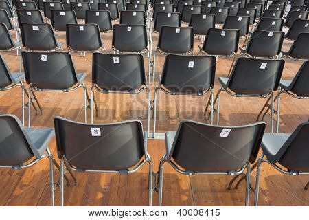 Empty numbered chairs