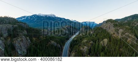 Aerial Panoramic View Of The Famous Scenic Drive, Sea To Sky Highway, During A Sunny Sunset. Located