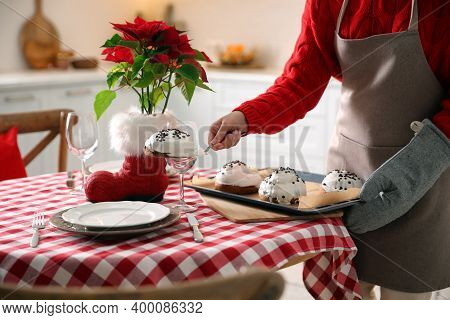 Woman With Sweet Buns For Christmas Dinner In Kitchen, Closeup