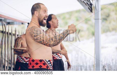 Rotorua, New Zealand -december-11-2017 : Maori Tribes Traditional War Cry. The Maori Are The Indigen