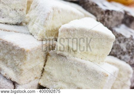 Pieces Of Fresh Baked Homemade Cake With Icing And Desiccated Coconut