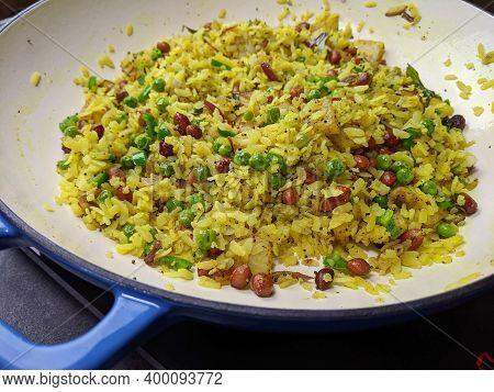 Kanda Batata Poha, A Spicy, Tangy Maharashtrian Breakfast Made Of Fermented Beated Rice.
