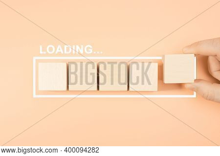 Loading Bar With Wood Cube On Pastel Background. Wooden Blocks With The Word Loading In Loading Bar