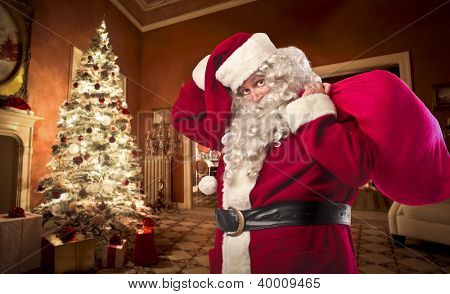 Santa Claus in a house with his presents sack