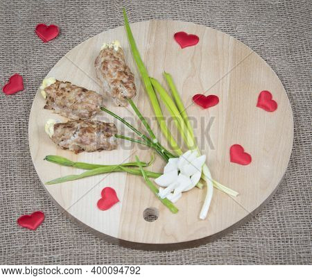 Flowers Made Of Meat On Wooden Cutting Board, Red Hearts And Natural Burlap Background. Food Art Ide