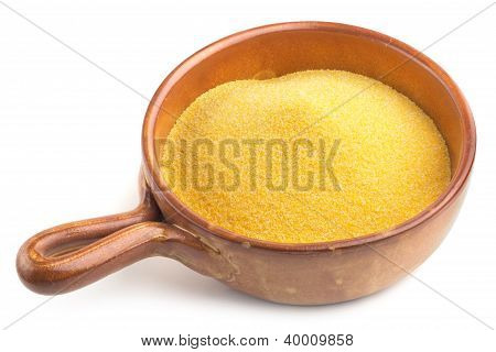 earthenware bowl with cornmeal on white background