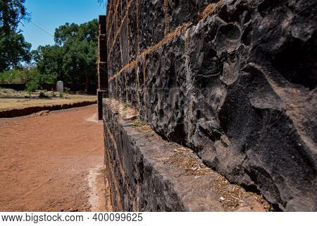 Wall Of Ancient Fort Or Castle In India. Wall Made By Black Stone.