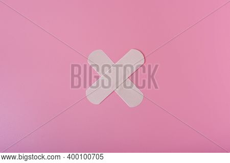 Sticking Plasters On Pink Background, Top View. Space For Text