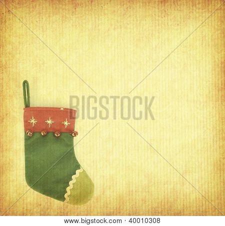 red Christmas stocking on grunged paper background