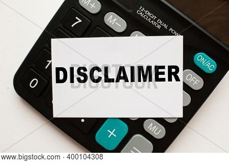 Card With Text Disclaimer On The Calculator, White Background. Business Concept
