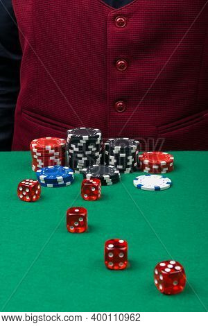 Close-up Of Red Dice On The Green Cloth Of The Dice Table, There Is Space For Writing On A Maroon Ve