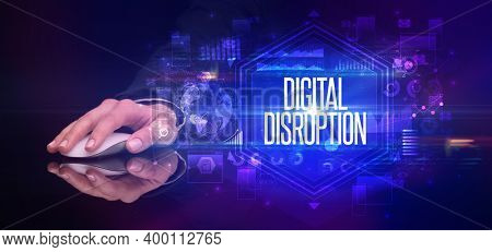 hand holding wireless peripheral with DIGITAL DISRUPTION inscription, cyber security concept