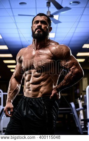 Active Strong Man With Beard And Perfect Abdominal Muscle During Heavy Workout Training In Night Spo