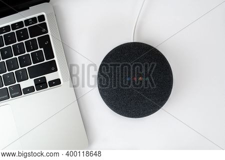 London, United Kingdom - 19 December 2020: Charcoal Google Nest Home Mini Smart Speaker With Built I