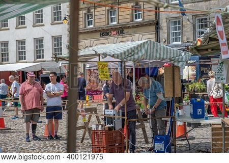 Richmond, North Yorkshire, Uk - August 1, 2020: A Man Washes His Hands After Queuing As A Precaution