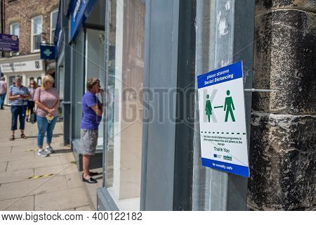 Richmond, North Yorkshire, Uk - August 1, 2020: A Sign Asking For People To Maintain Social Distanci