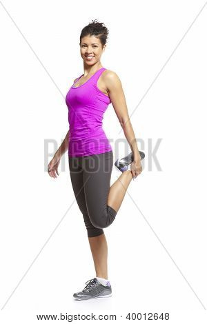 Muscular Young Woman Stretching In Sports Outfit
