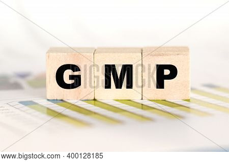 Gmp Word Written On A Wooden Cubes. Can Be Used For Business, Marketing, Financial Concept. Selectiv