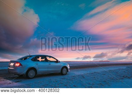 Gomel, Belarus - January 26, 2017: Volkswagen Polo Car Sedan Parked On A Snowy Roadside Of Country R