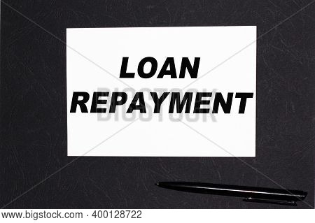 Loan Repayment.notebooks And A Pen On The Table For Information. . Business, Marketing, Financial Co