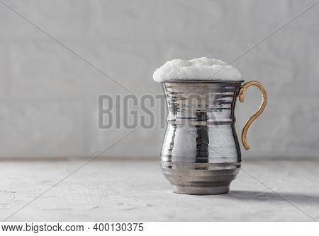Ayran. Traditional Turkish Yoghurt Drink With Foam In Silver Metal Cup.