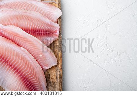 Tilapia Fish Skinless Meat, On White Background, Top View With Copy Space For Text