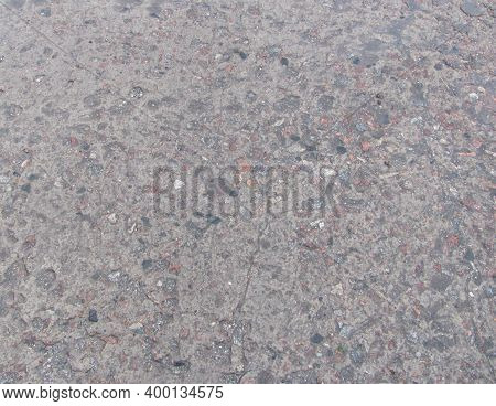 Wet Concrete Texture Background With Small Stones In It