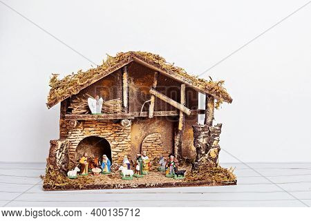 Christmas Hygge Interior With Christmas Nativity Scene With Holy Family And Three Wise Men