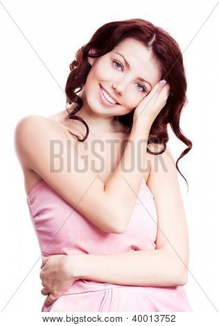 portrait of a young beautiful brunette woman touching her long curly hair, isolated on white background