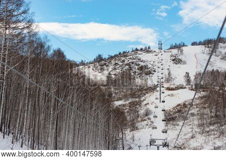 Ski Lift For Skiers. Chairlift To The Top. Ski Track And Alpine Skiing.