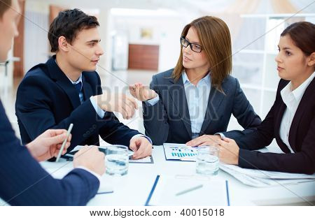 Group of confident business partners planning work at meeting