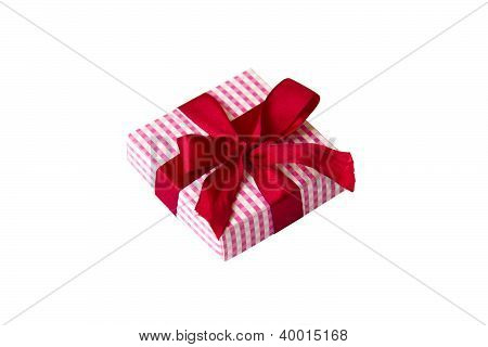 Small giftbox with red bow, isolated