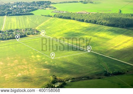 Aerial View Of Green Field, Position Point And Boundary Line To Show Location And Area. A Tract Of L