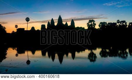 Angkor Wat Skyline Silhouette During Sunrise, Siem Riep, Cambodia. Angkor Wat Is The Largest Religio