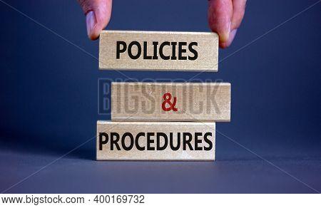 Policies And Procedures Symbol. Wooden Blocks Form The Words 'policies And Procedures' On Grey Backg