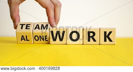 Alone Or Teamwork. Male Hand Flips Wooden Cubes And Changes Words 'alone Work' To 'teamwork'. Beauti