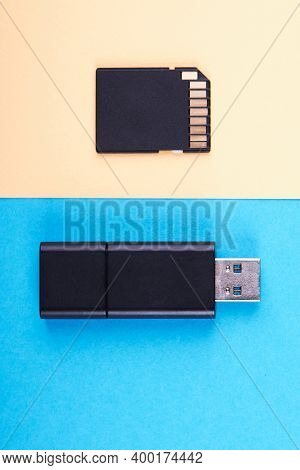 Usb Flash Stick And Micro Sd Memory Card On Blue And Yellow Background. Different Kind Of Portable S